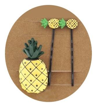 Schuifspeldjes + elastiek ananas geel